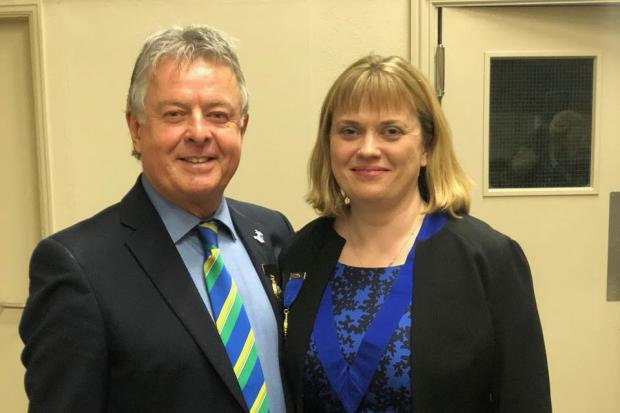 Pembrokeshire Agricultural Society president Nicola Owen with her predecessor Brian Harries BEM. PICTURE: PAS