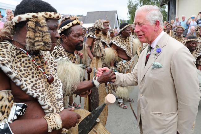 The Prince of Wales meets members of the Zulu 'impi' regiment during the 100th Royal Welsh Show at the Royal Welsh Showground today PICTURE: Chris Jackson/PA Wire