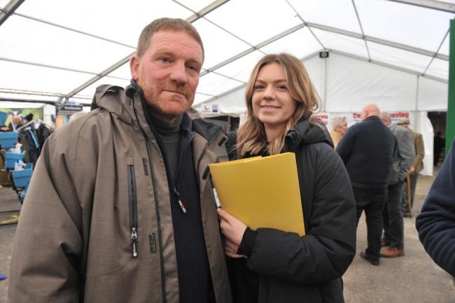 Chris Mossman and his daughter Lottie gathering signatures at the Welsh Dairy Show