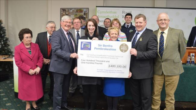 The Pembrokeshire team present their final cheque at the recent council meeting