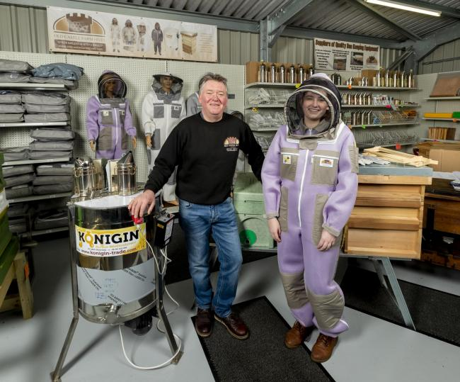 Ian Roberts of Old Castle Farm Hives in his Bee Shop with his new Queen Bee beekeeping suit that has been created for women beekeepers