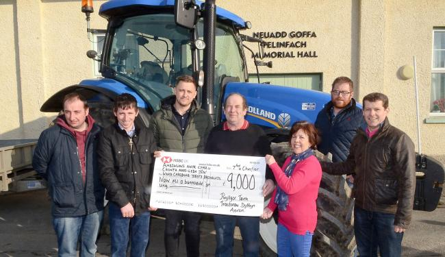 Following another successful Taith Tractorau Dyffryn Aeron Tractor run during the past year that raised £9,000, which will be shared equally between Bronglais Hospital cardiology unit; Air Ambulance Wales and Mari-Leisa Jên Fund. From left are