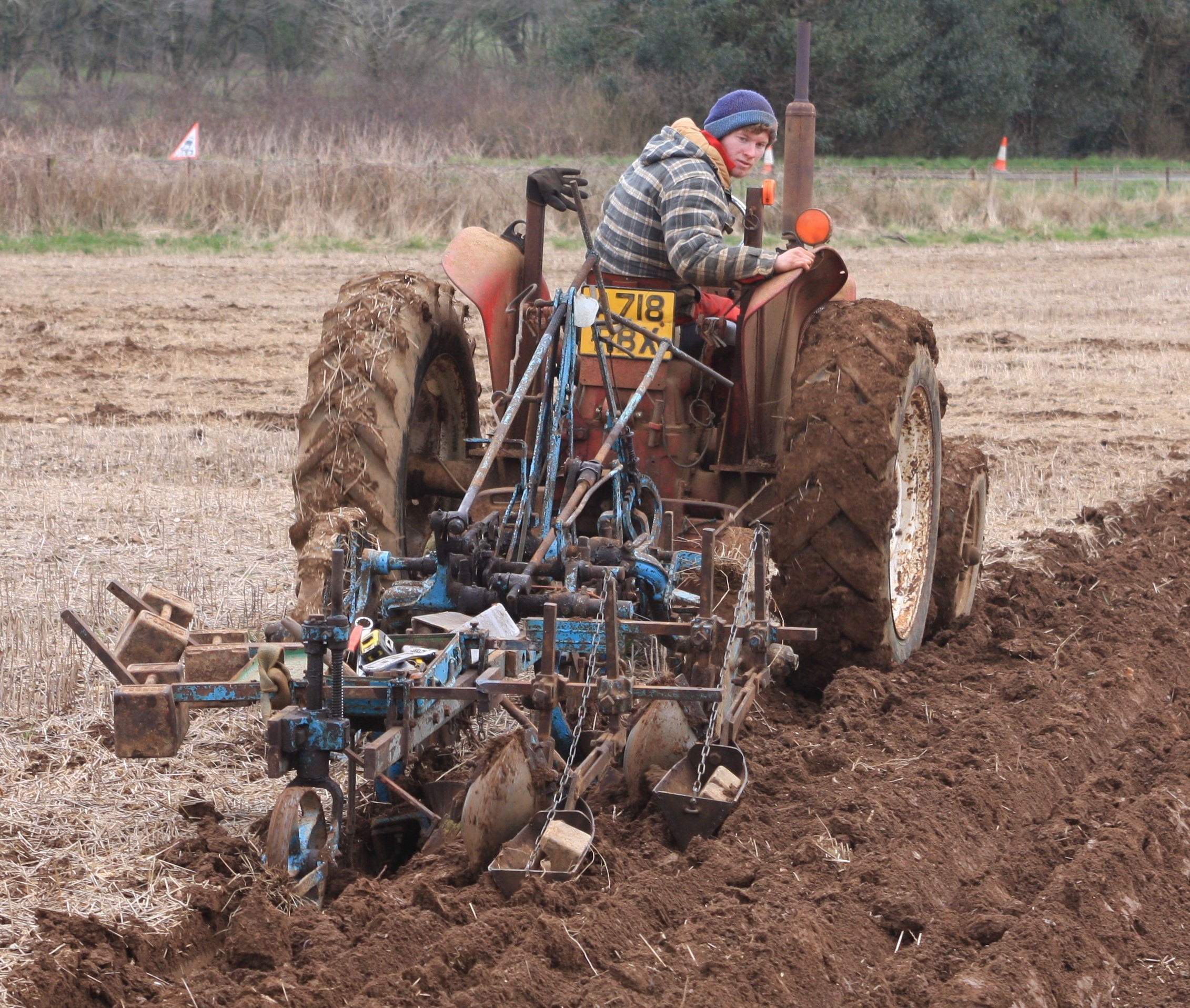 Young challenger Tom Chinn working with an International B250 tractor drawing an intricately adjusted two furrow high-cut plough PICTURE: Meyrick Brown