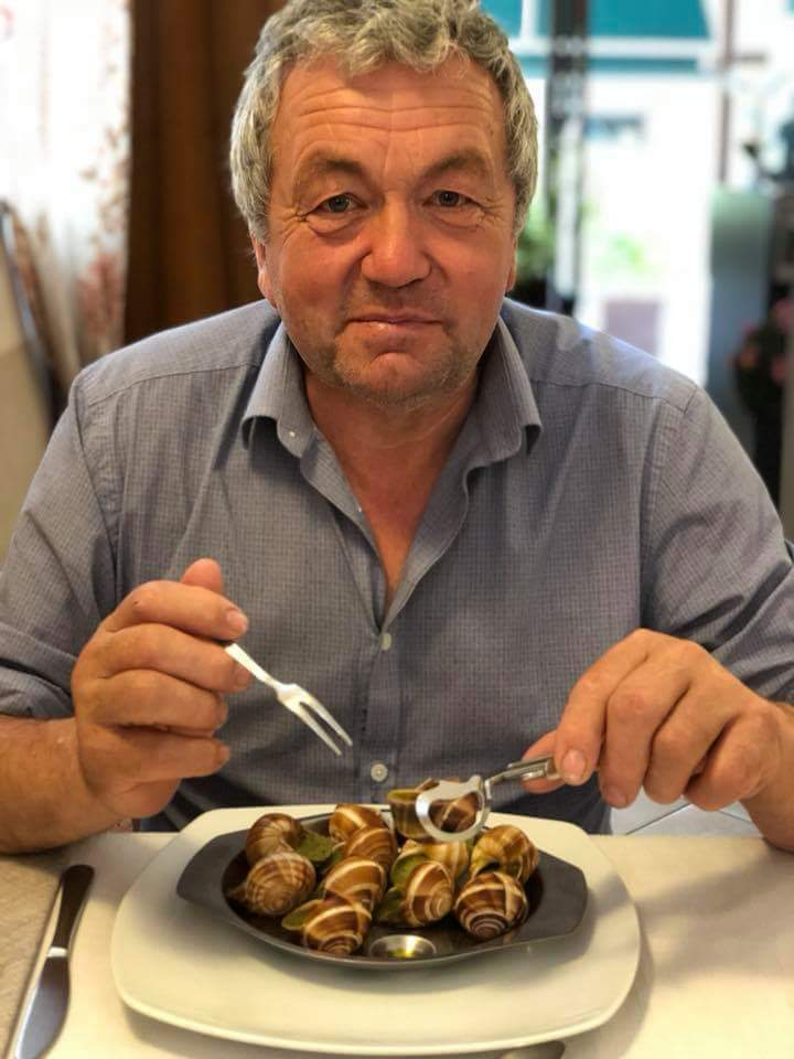 Richard Hughes eating snails in Italy