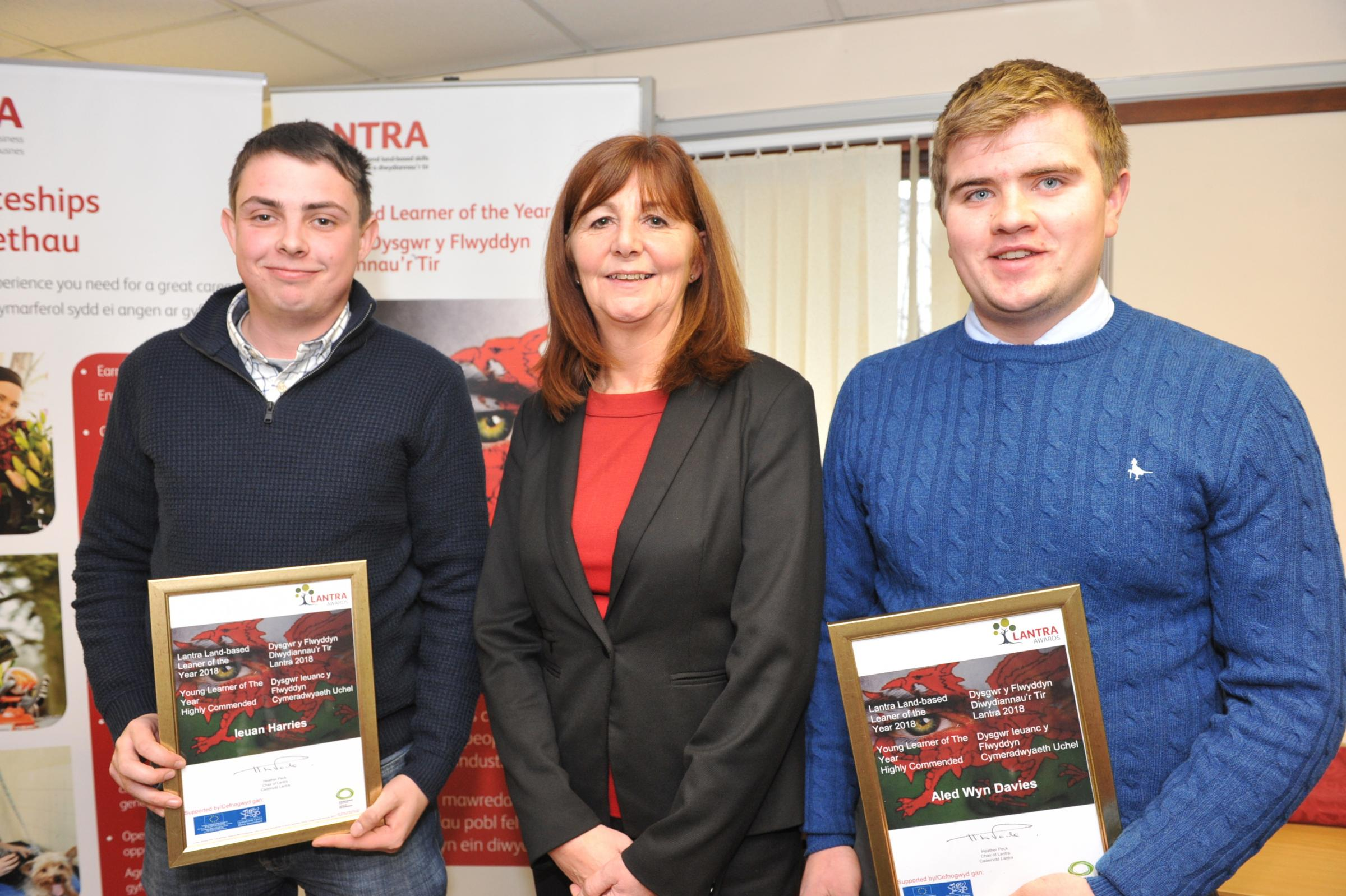 Lantra winner Ieuan Harries and Aled Wyn Davies with Lesley Griffiths
